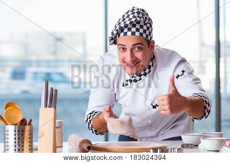 Young man cooking cookies in kitchen