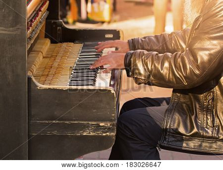 Unidentified person playing the piano on the street
