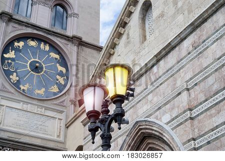 detail of the astronomical watch of the cathedral of Messina with the lit lamp