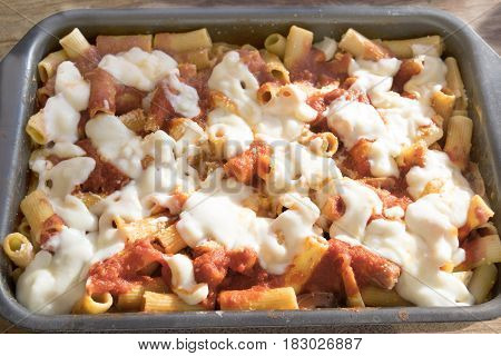 baking tray of baked pasta with mozzarella