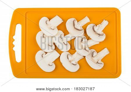 Slices Of Mushrooms On Orange Cutting Board Isolated On White