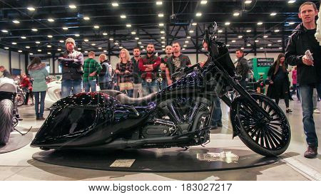 St. Petersburg Russia - 15 April, Black streamlined motorbike,15 April, 2017. International Motor Show IMIS-2017 in Expoforurum. Motorcycles and motoconcepts presented at St. Petersburg Motor Show.