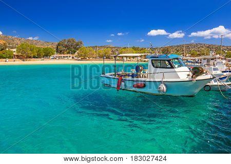 Blue lagoon of Marathi bay with fishing boats on Crete, Greece