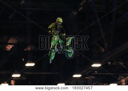 St. Petersburg Russia - 15 April, A biker performing a trick,15 April, 2017. International Motor Show IMIS-2017 in Expoforurum. Moto show at the St. Petersburg moto salon.