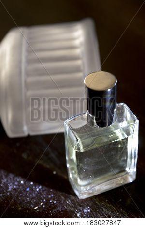 detail of perfume bottles in light and dark