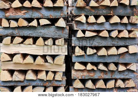 Pile of firewood crossover tree diagonal abstract