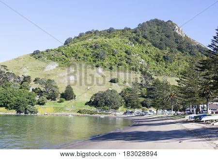 The view of Mount Maunganui resort town beach and the same name mountain (New Zealand).