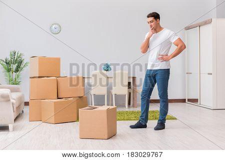 Man caryying boxes at home