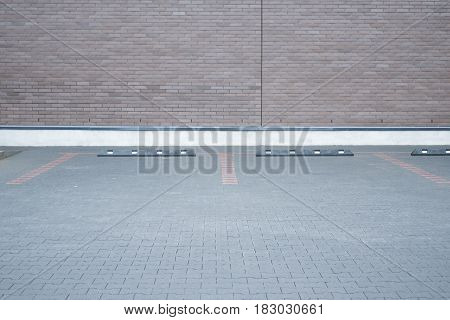 Outdoor empty space car parking and modern brick wall as background