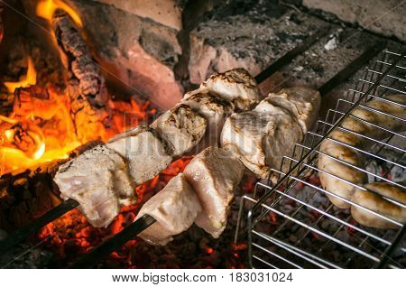 Barbecue meat steaks on the grill with flames. Meat on the coals. barbecue vacation concept close up.