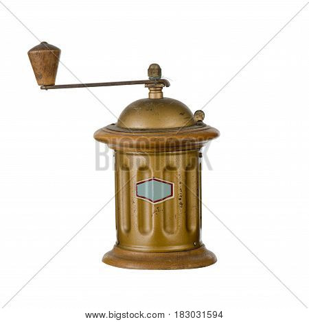 Iron round coffee grinder of bronze color with a handle on a white background