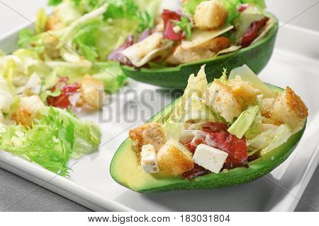Plate with chicken salad in boats from avocado