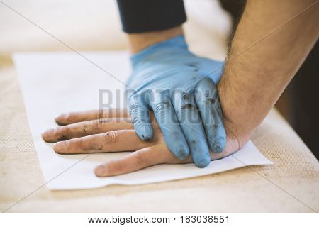 The Process Of Getting Samples Of Fingerprints Hands For Further Study