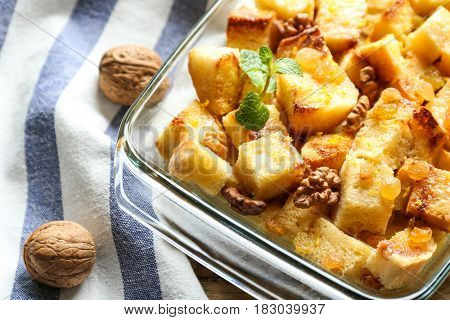 Delicious bread pudding with raisins in glass dish