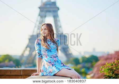 Young Woman In Blue Dress In Paris Near The Eiffel Tower