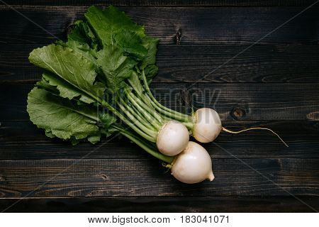 Organic Vegetables. Fresh Harvested Turnip On The Dark Wooden Background, Top View
