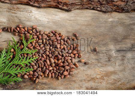 Unshelled Pine Nuts On Aged Wood