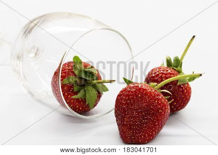 Strawberry berries in a glass of wine.
