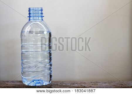 Drinking water in plastic bottles on wooden floor