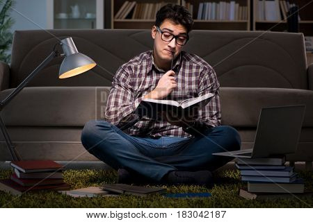 Student reading books preparing for exams