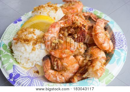 Plate lunch of Hawaiian Kahuku shrimp from a food truck on the island of Oahu Hawaii.