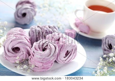 Sweet Zephyr With Cup Of Tea On Blue Wooden Table
