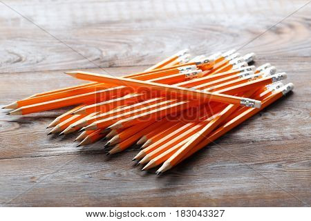 Yellow pencils on brown wooden table, close up