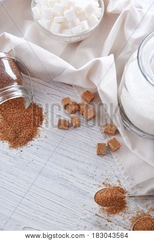 Beautiful composition with sugar on wooden table