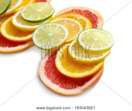 Fresh slices of citrus fruits on white background