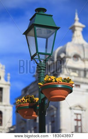 Typical metal street lamp at Mafra (Portugal)