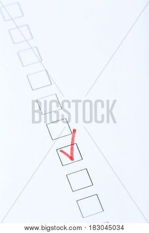 Check boxes on white paper, close up