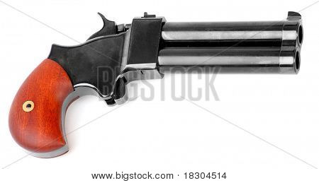 An antique 2 shot .45 cal percussion derringer hand gun isolated on a white background. Self defense weapon.