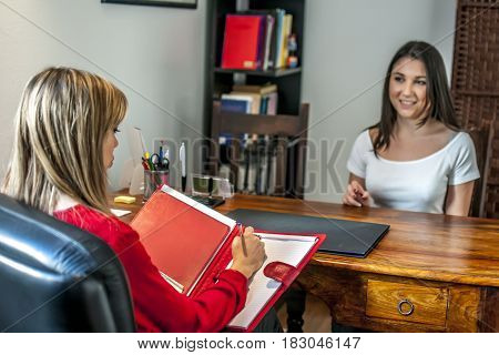 young girl talikng with a psychologist for a consultation therapy