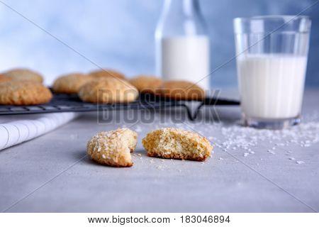 Broken tasty coconut cookie on table