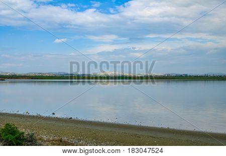 View of Aliki salt lake at Larnaca springtime shot on bright March day.