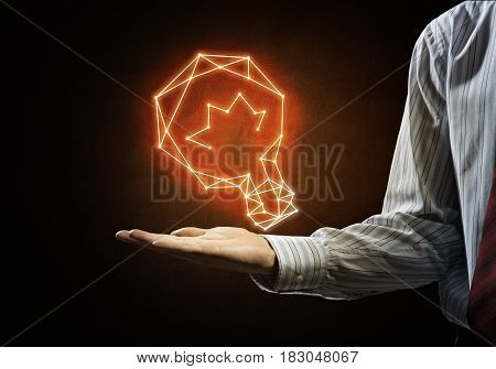 Close of businessman hand holding glowing light bulb icon