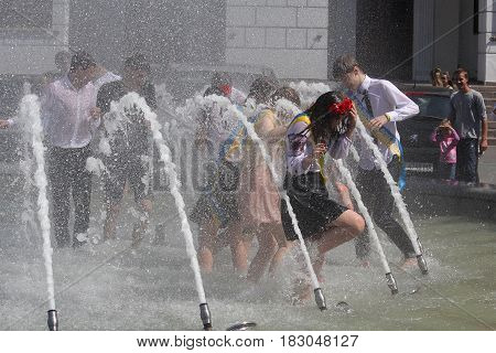 Kiev Ukraine - May 27 2016: Kiev graduates bathing in fountains celebrating the graduation from school