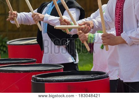 Trio of drummers in national Ukrainian costume