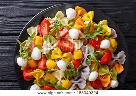 Italian Food: Farfalle Pasta With Vegetables And Mozzarella Close-up. Horizontal Top View