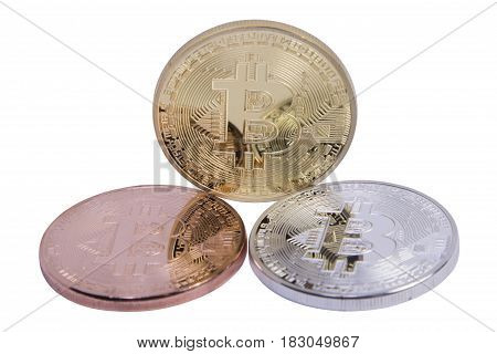 gold silver and bronze coins bitcoin on a white background