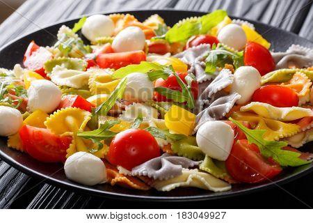 Farfalle Pasta With Tomatoes, Arugula And Mozzarella Close-up. Horizontal