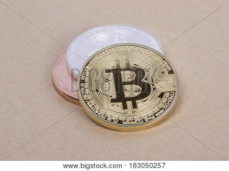 gold silver and bronze coins bitcoin on the background of bright paper
