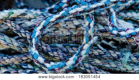 Bunch of colorful nautical ropes close by the docks of a fishing harbor