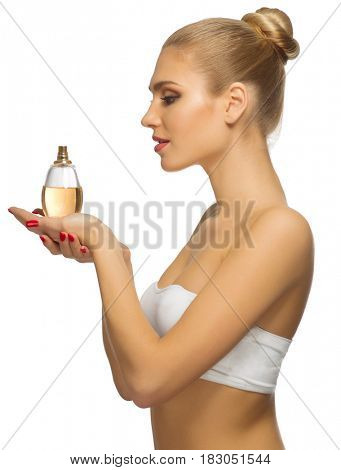 Young girl with perfume isolated