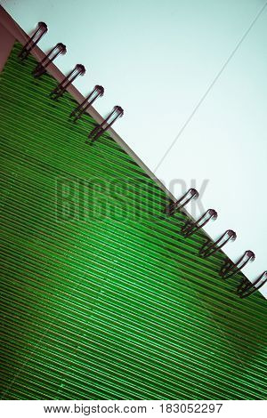 background for graphic design with green fluttered paper