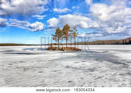 Spring landscape. Spilling the Pista River. Lake Hirasjarvi. Russia. Karelia