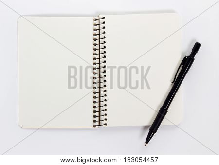 Blank notebook with pen isolated on white background.