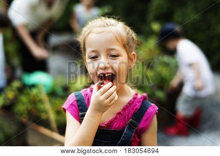 Kids having fun gardening outdoor