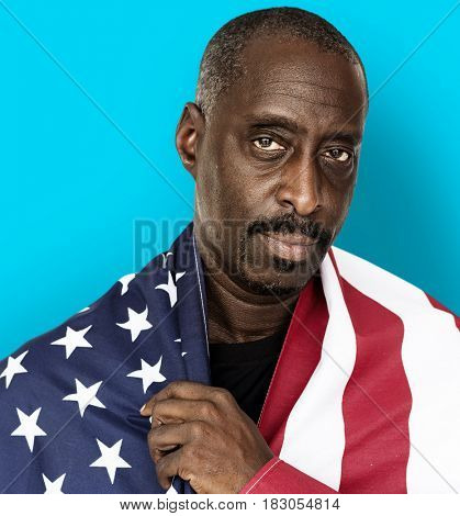 Adult Man Covered with American Flag Nationality Studio Portrait