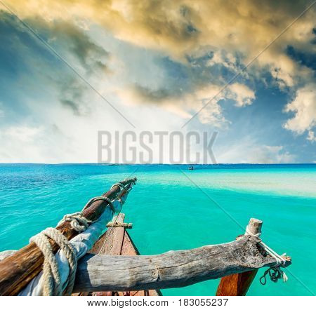 amazing view of blue sky and turquiose ocean from wooden african boat